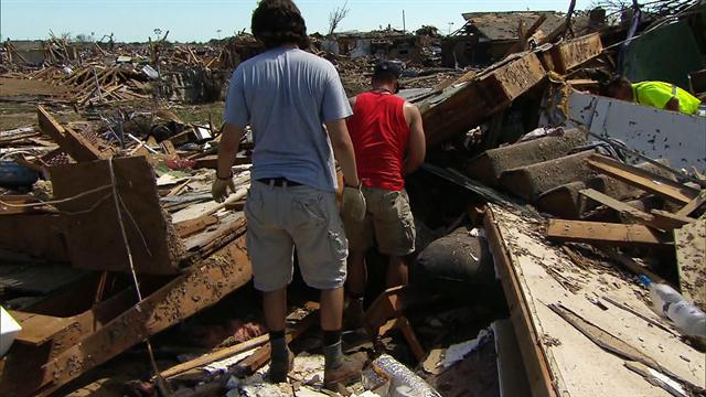 Residents return to tornado-ravaged neighborhoods