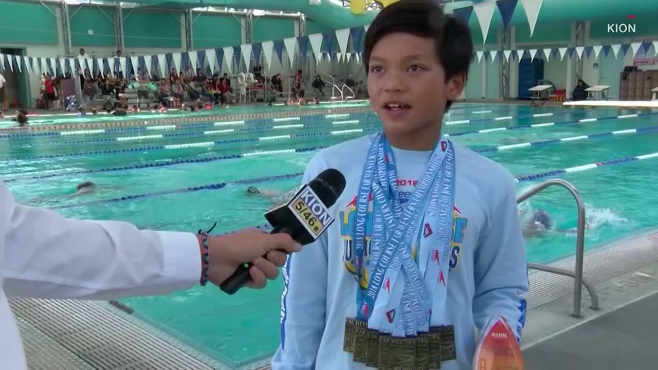 10-year-old California swimmer Clark Kent Apuada breaks Michael Phelps' longest-standing record