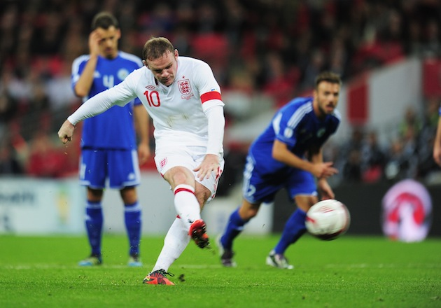 Wayne Rooney, captain of England, scores the opening goal from the penalty spot during the FIFA 2014 World Cup qualifying match between England and San Marino at Wembley Stadium. (Photo by Shaun Botterill/Getty Images)