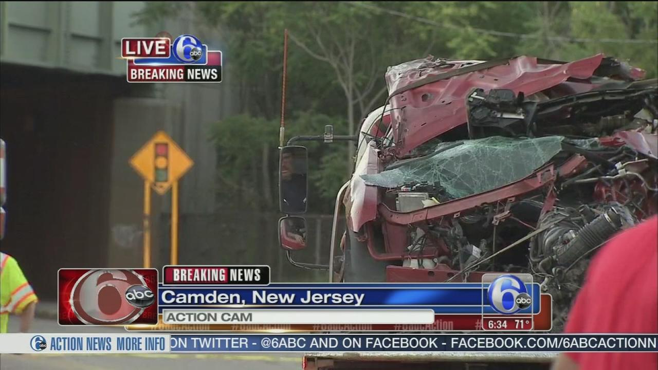 Car crashes into homes, parked cars in Camden