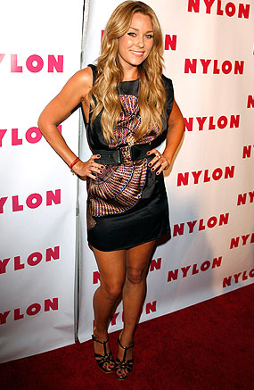 """The Hills"" hottie Lauren Conrad belts her black Richard Ruiz sheath dress. - Jean Baptiste Lacroix/WireImage.com"