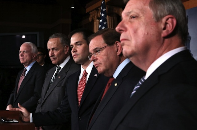 Some members of the bipartisan group of senators who drafted the immigration bill in January. It passed the Senate on Thursday. (Alex Wong/Getty Images)