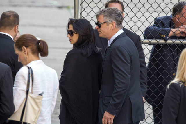 Hilaria Thomas and Alec Baldwin arrive at James Gandolfini's funeral in New York, June 27, 2013. (Lucas Jackson/Reuters)