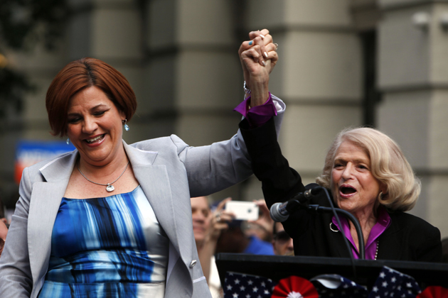 Mayoral candidate Christine Quinn stands with Edith Windsor at a rally celebrating the Supreme Court's rejection of DOMA. (Jason McCrow/AP)