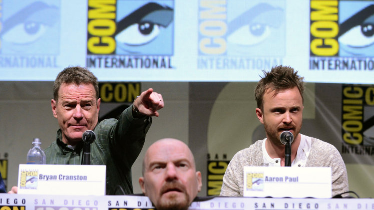 "Bryan Cranston and Aaron Paul speak onstage at the ""Breaking Bad"" panel during Comic-Con International 2013."