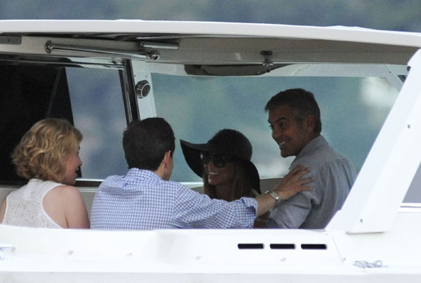 "On Clooney's boat, which is named ""Boat,"" with Chris Wallace and his wife (E-pics/Splash News)"
