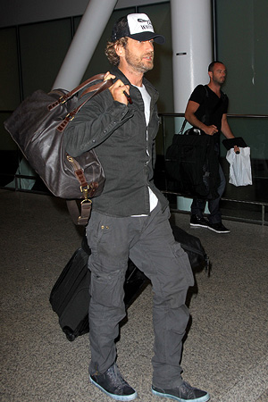 Gerard Butler touched down in Toronto on Thursday to attend the Toronto International Film Festival. - Macca/Todd G/Splash News