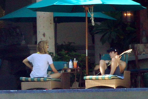 Nick kicks back with his best girl and his guitar. - Clasos.com/Splash News