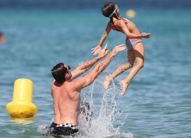 Hugh looked like he was having just as much fun as his kids! - Splash News