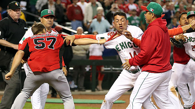 Canada and Mexico brawls during the ninth inning of Saturday's game. (Getty Images)