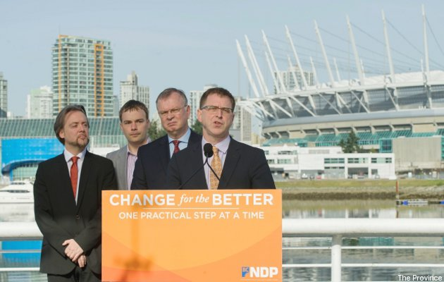 NDP leader Adrian Dix (at podium) has promised to investigate selling B.C. Place.