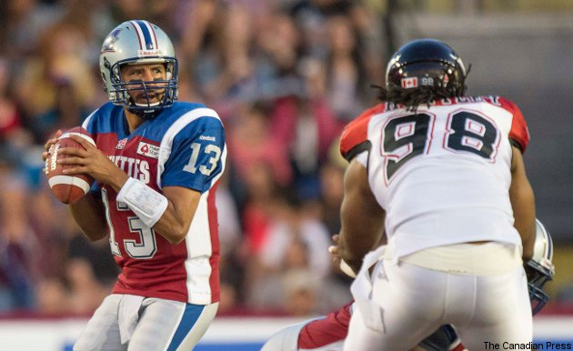 Montreal's line couldn't keep Kevin Huntley (#98) and Calgary from sacking Anthony Calvillo Friday.