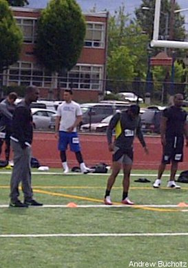Eric Taylor (centre) sets up to run a 40-yard dash at Saturday's camp.