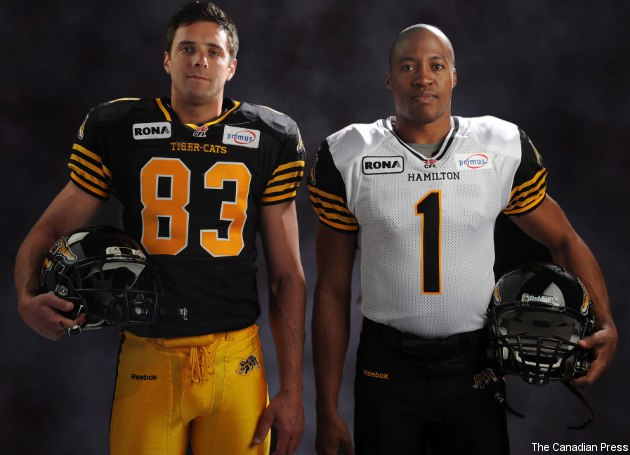 Andy Fantuz (L) and Henry Burris in the Tiger-Cats' new uniforms.