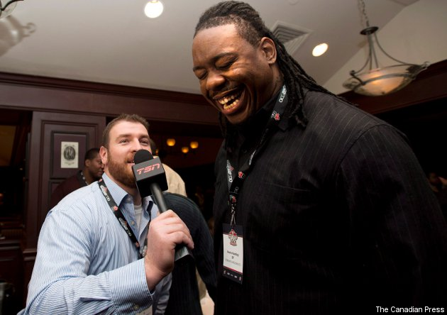 Kevin Huntley (R), with Marc Parenteau at the 2012 Grey Cup media breakfast, was cut Saturday.