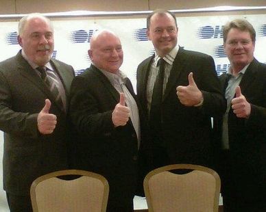 Scott Abbott (second from left) after the Battalion move received league approval (OHL Images)