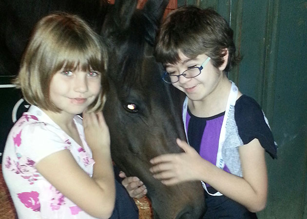 Hope (right) with one of Doug O'Neill's horses at the Breeders Cup. (Hudson family)
