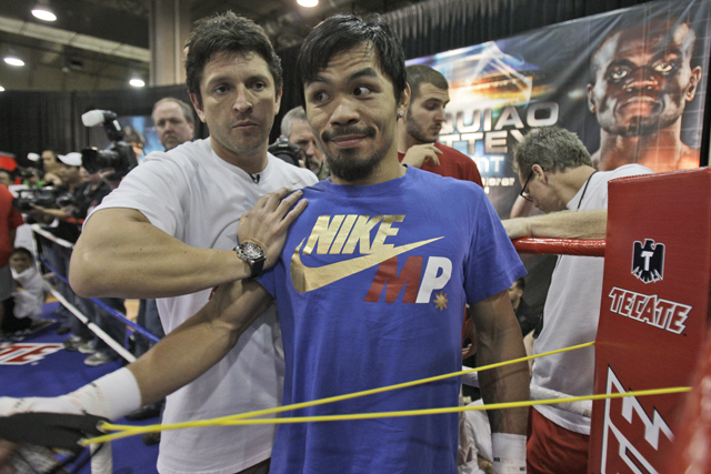Alex Ariza (L) worked with Manny Pacquiao since 2008 (AP)