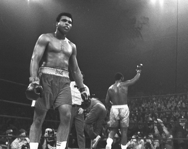 Ali walks to his corner as Frazier celebrates after the fight (AP file)