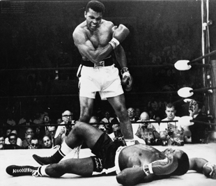 Muhammad Ali stands over Sonny Liston (AP file photo)