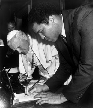 Pope John Paul II and Muhammad Ali (AP file photo)
