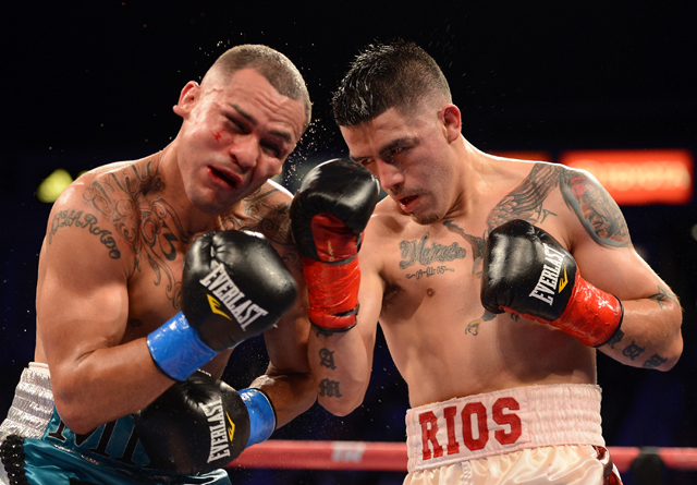 Mike Alvarado (L) battles Brandon Rios on Oct. 13 (Getty Images)