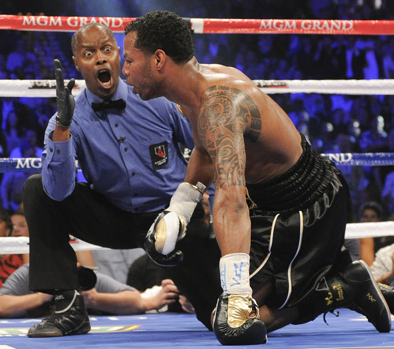 Kenny Bayless, counting over Shane Mosley, will referee the Floyd Mayweather-Canelo Alvarez bout (AP)