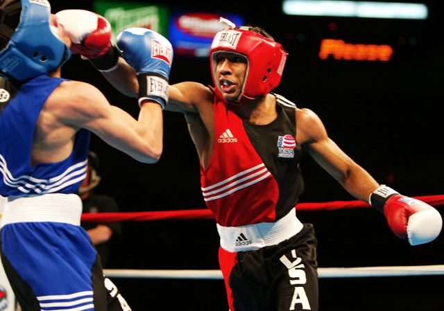 Mickey Bey Jr. (R) in the 2004 Olympic box-offs, had a 30-1 T/E ratio after a Feb. 2 fight (Getty)