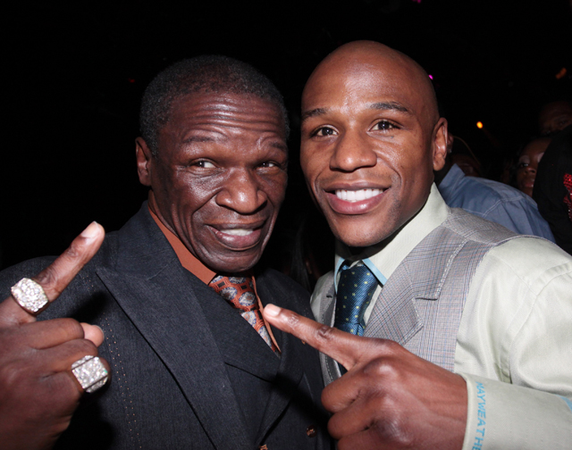 Floyd Mayweather Jr. (R) celebrates a win over Shane Mosley with his father, Floyd Sr. (Getty Images)