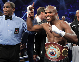 Referee Robert Byrd raises Timothy Bradley's arm as new champion (Chris Farina/Top Rank)