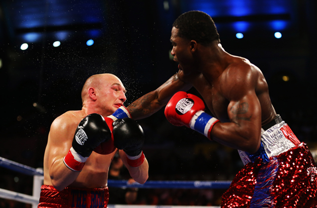 Adrien Broner (R) connects with a right on Gavin Rees on Feb. 16 (Getty Images)