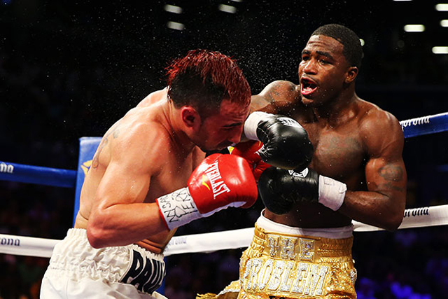 Adrien Broner (R) connects on Paulie Malignaggi in their bout Saturday (Getty)