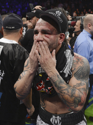 Miguel Cotto was beaten up by Austin Trout (AP)