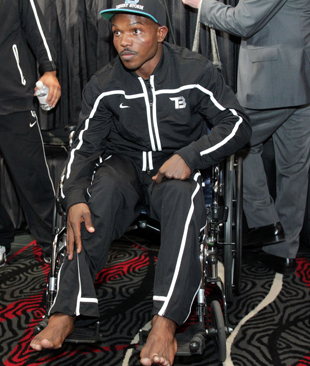 Timothy Bradley shows his right foot injury (Chris Farina/Top Rank)