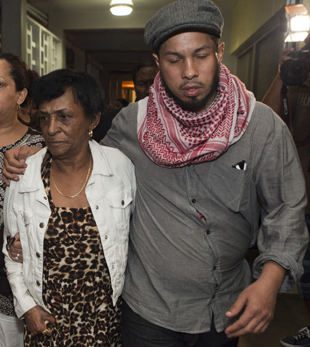 Hector Camacho's mother, Maria Matias, and his son, Hector Jr., leaving the hospital (AP)