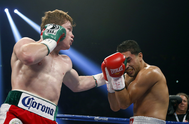 Canelo Alvarez (L) will face Austin Trout on April 20 in San Antonio (AP)