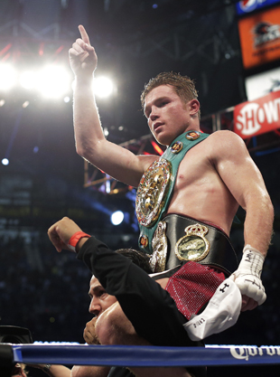 Canelo Alvarez celebrates an April 20 win over Austin Trout (AP)