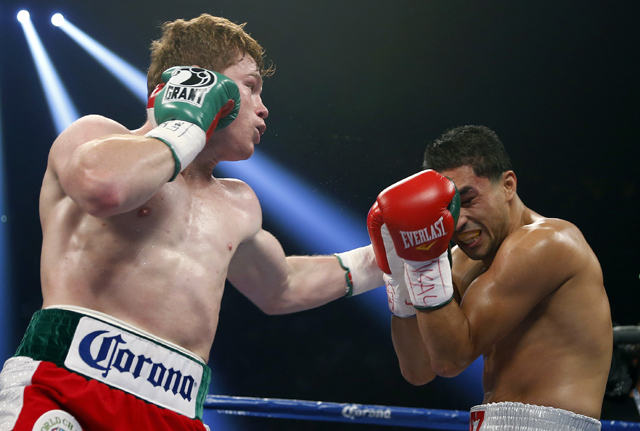 Canelo Alvarez (L) drew 1.036 million viewers to Showtime for his win over Josesito Lopez (AP)