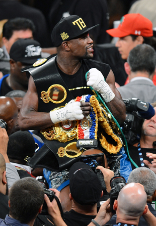 Floyd Mayweather celebrates a win nearly stolen from him (Getty)