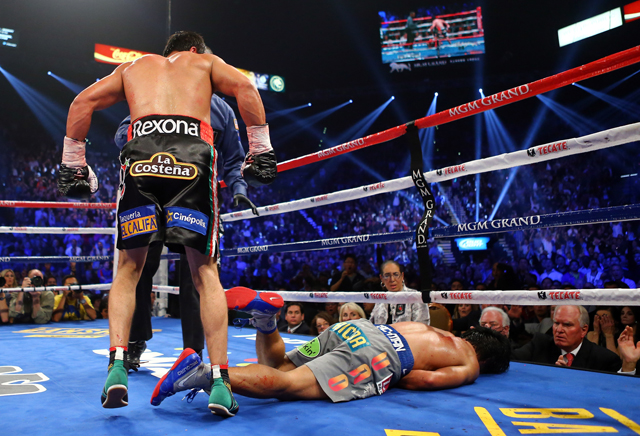 Juan Manuel Marquez (L) goes to a corner after knocking out Manny Pacquiao (Getty)