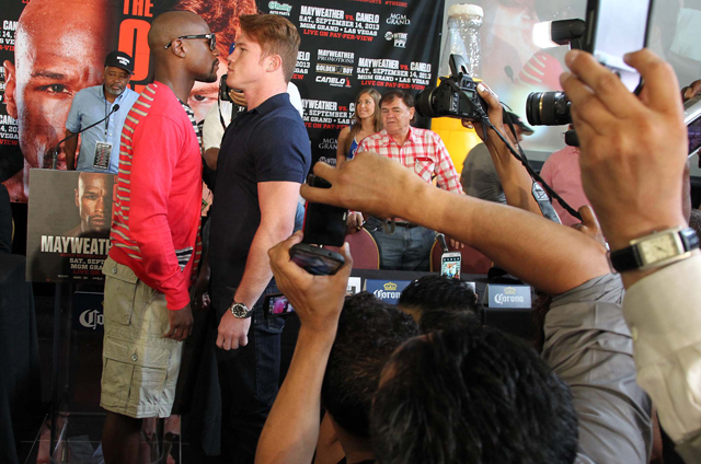 Floyd Mayweather and Canelo Alvarez pose at a news conference in Houston (Tom Casino/Showtime)