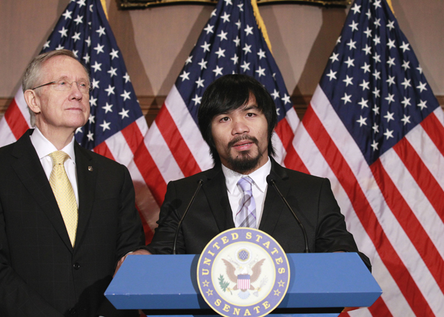 Senate Majority Leader Harry Reid (D-Nev.) with boxer Manny Pacquiao (AP)