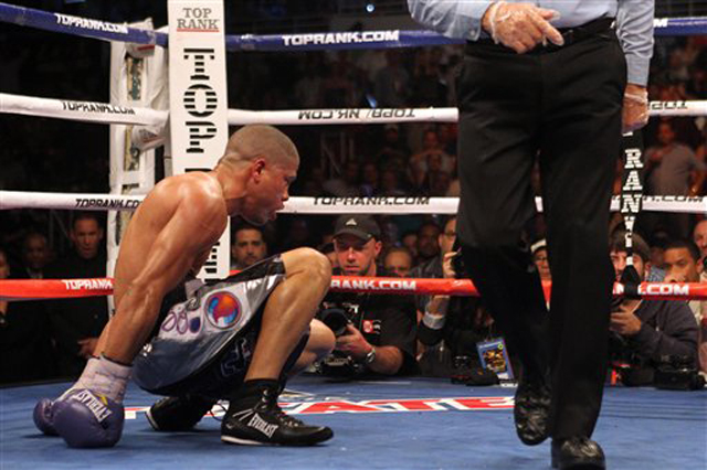 Juan Manuel Lopez tries to get up on March 10 after being knocked down by Orlando Salido (AP)