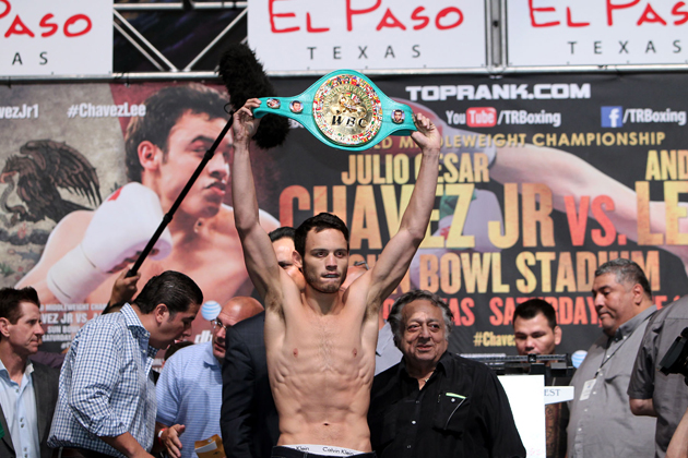 Julio Cesar Chavez Jr. shows off his WBC middleweight title belt (Chris Farina/Top Rank)