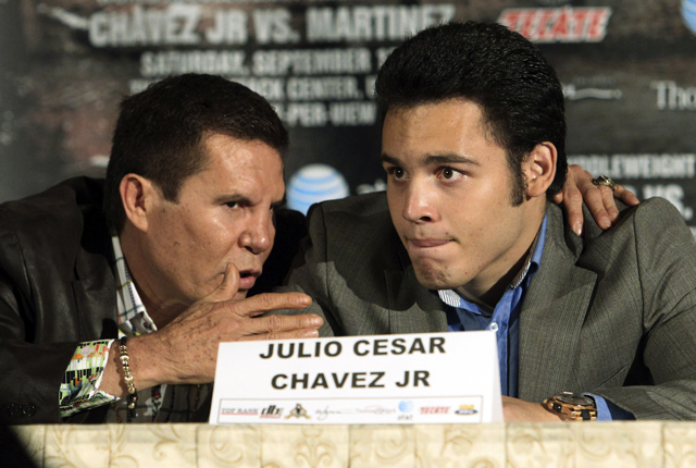 Julio Cesar Chavez Sr. confers with his son, Julio Cesar Chavez Jr. (AP)