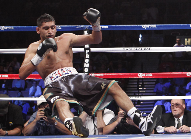 Amir Khan hired Virgil Hunter as trainer after getting knocked out by Danny Garcia (AP)