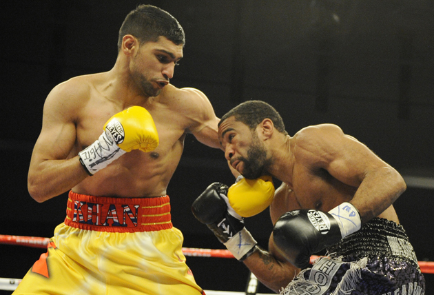 The Amir Khan-Lamont Peterson rematch was canceled. (AP)