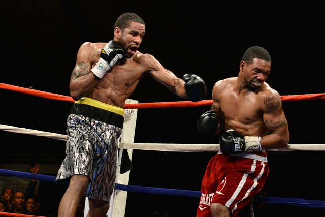 Lamont Peterson (L) did what he needed to do, which included hitting Kendall Holt a lot. (Getty Images)