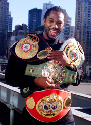 The great Lennox Lewis with his belts (AP)