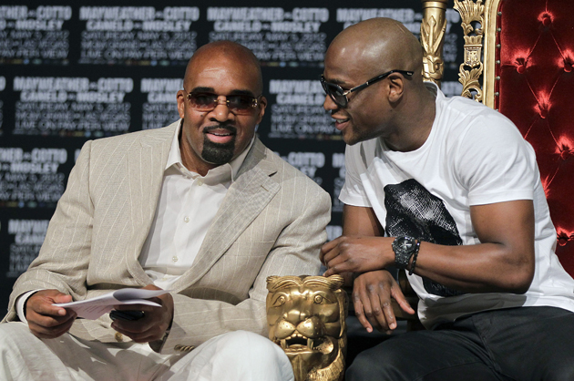Leonard Ellerbe (L) and Floyd Mayweather Jr. (AP)